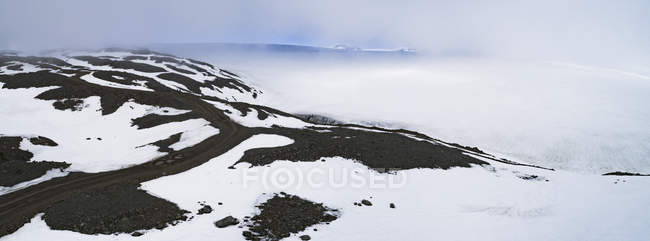 Panoramic view of landscape during foggy weather against sky — Stock Photo