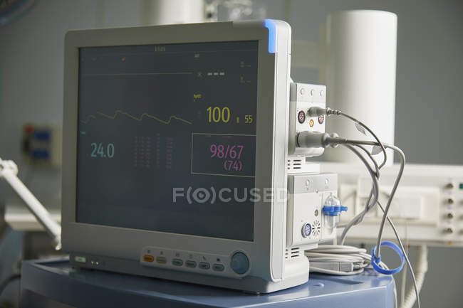 Close up of monitoring equipment with heart dieagram in hospital ward — Stock Photo