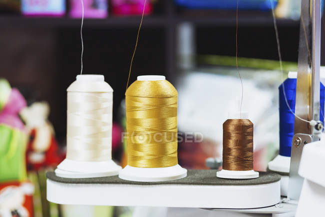 Close up view of various spools on sewing machine — Stock Photo