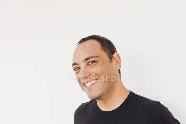 Portrait of cheerful man against white background — Stock Photo