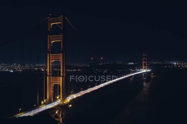 High angle view of Golden Gate Bridge illuminated with traffic at night — Stock Photo