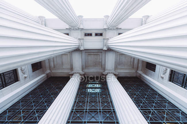 Bottom view of building facade with columns — Stock Photo