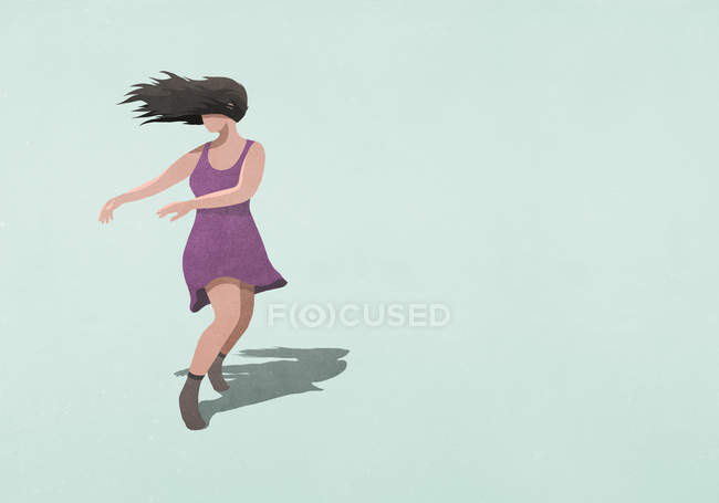 Carefree woman in dress dancing on blue background — Stock Photo