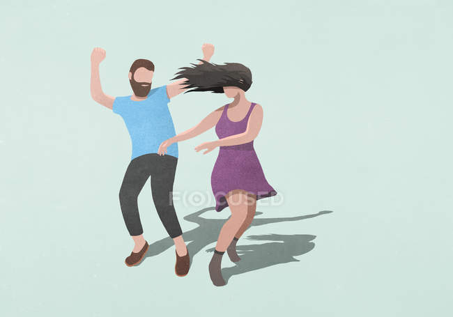Carefree couple dancing on blue background — Stock Photo