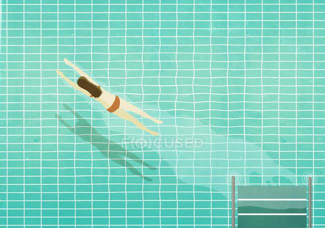 Woman in bikini diving into swimming pool — Stock Photo