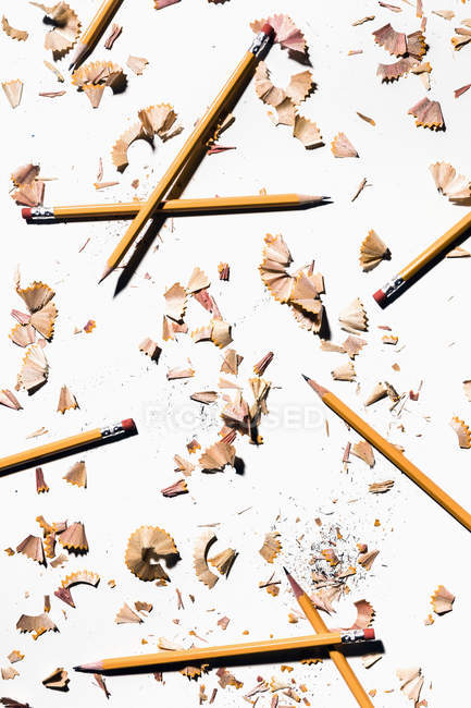 Pencils and shavings on white background — Stock Photo