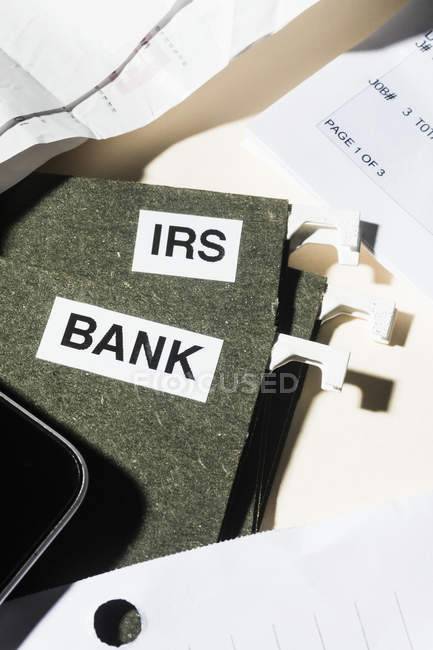 Close up bank and IRS tax files and finance paperwork — Stock Photo
