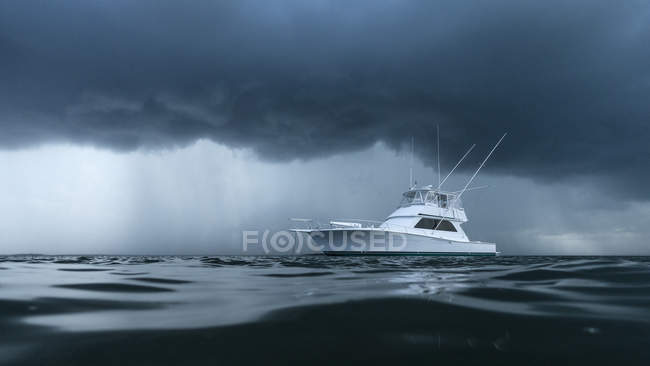 Yacht on ominous stormy ocean — Stock Photo
