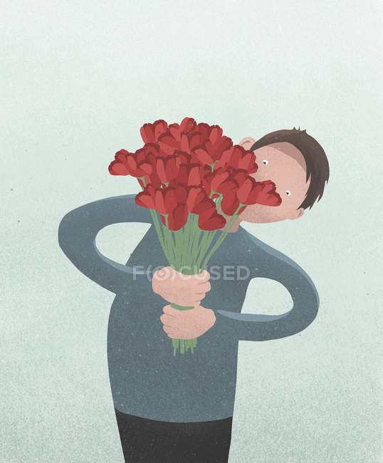 Man holding Valentines Day red tulip bouquet — Stock Photo