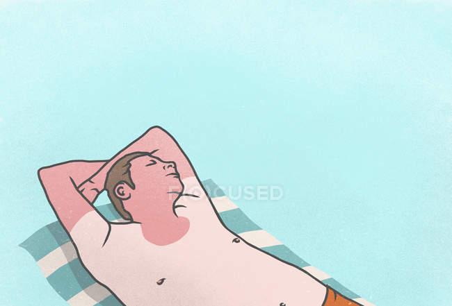Sunburned man sleeping on towel — Stock Photo