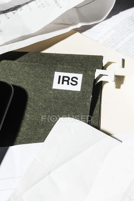 Close up IRS taxes file and finance paperwork — Stock Photo