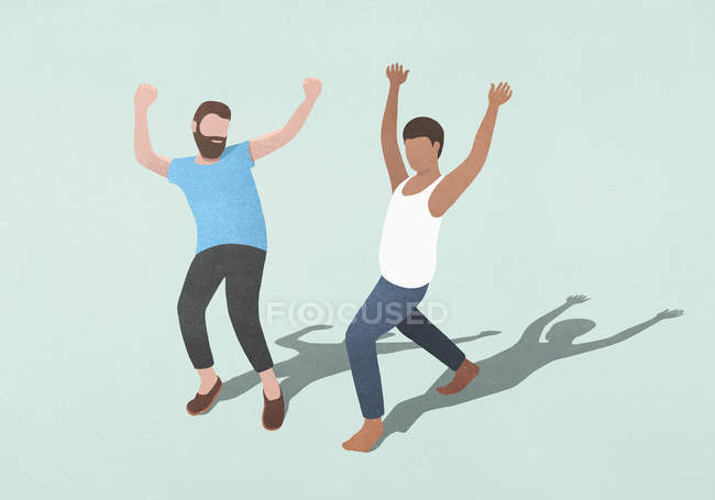 Carefree men dancing on blue background — Stock Photo