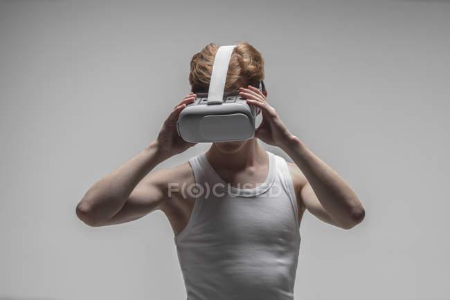 Young man using virtual reality simulator glasses — Stock Photo
