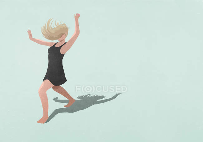 Carefree barefoot woman in dress dancing on blue background — Stock Photo
