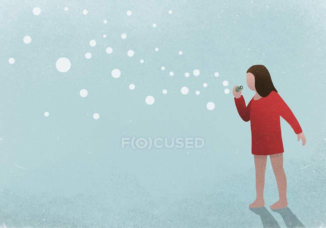 Ragazza soffiando bolle su sfondo blu — Foto stock