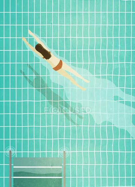 Женщина, ныряющая в бассейн — стоковое фото