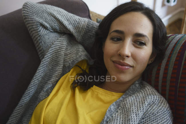 Serene woman relaxing on sofa — Stock Photo