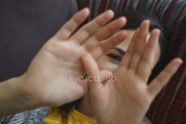 Portrait shy woman with hands in front of face — Stock Photo