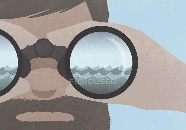 Reflection of sea in binoculars held by a man with a beard — Stock Photo