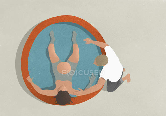 Directly above view of pregnant woman lying in birth pool with man kneeling at edge — Stock Photo