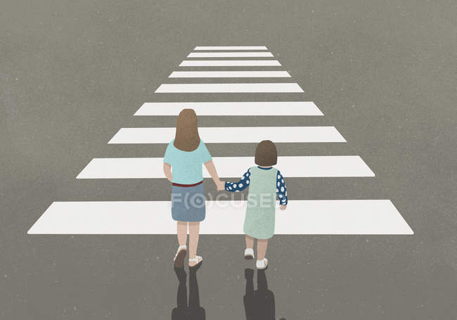 Woman and girl holding hands whilst walking through zebra crossing — Stock Photo