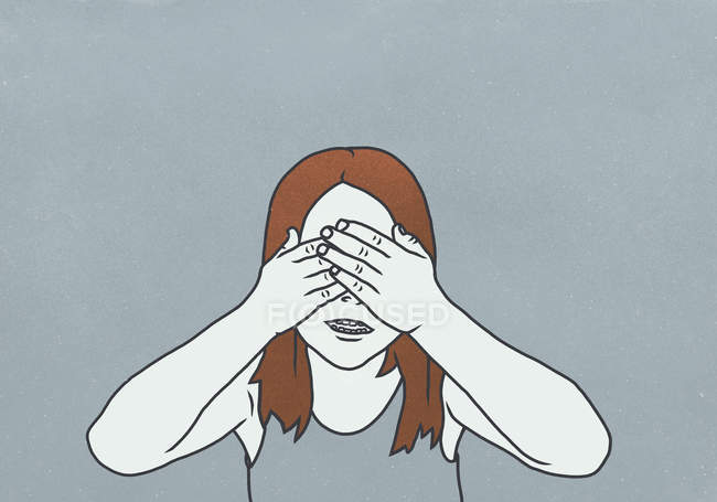 A girl with brown hair covering her eyes — Stock Photo