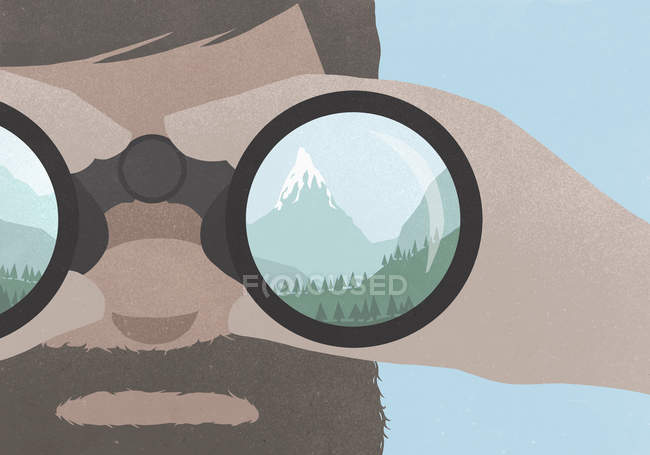 Reflection of a mountains in binoculars held by a man with a beard — Stock Photo