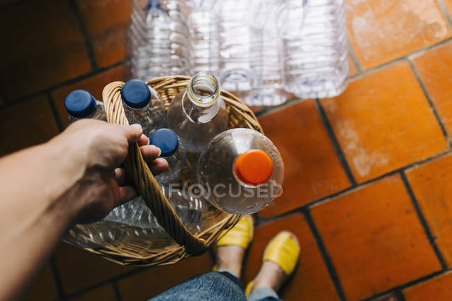 Personal perspective woman recycling plastic in basket — Stock Photo