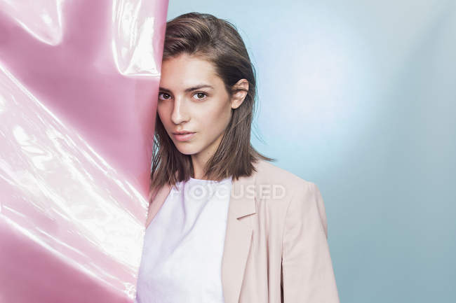 Portrait of a female fashion model posing with pink fabric — Stock Photo