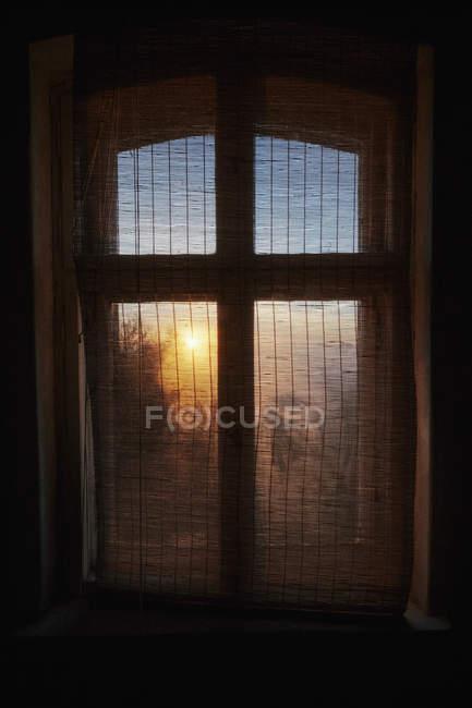 Ethereal sunrise behind gauze window curtain — Fotografia de Stock