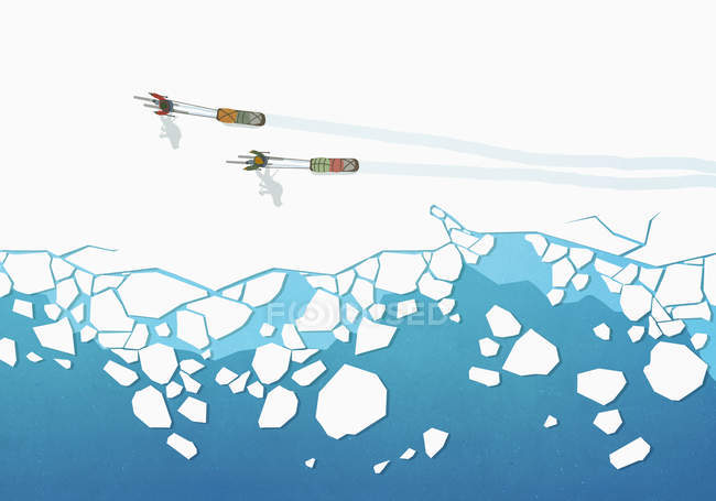 View from above people cross country skiing, pulling sleds over frozen ocean — Stock Photo