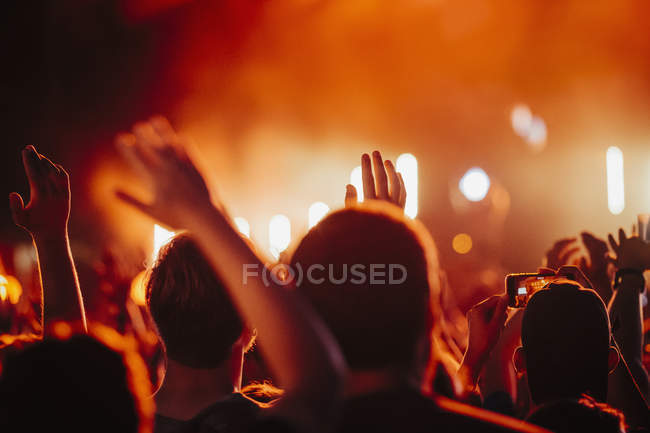 Crowd watching concert and cheering — Stock Photo