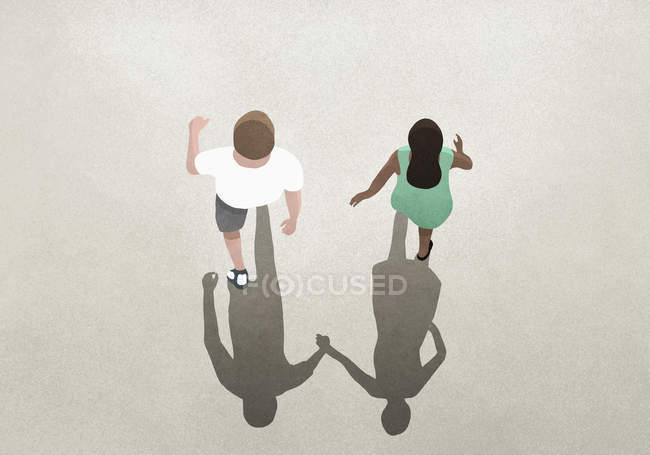 View from above shadow of couple holding hands — Stock Photo