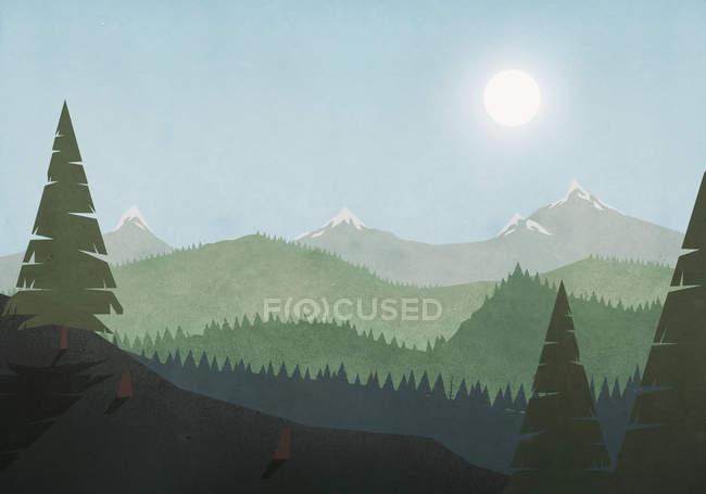 Sun shining over idyllic mountain and forest landscape — Stock Photo