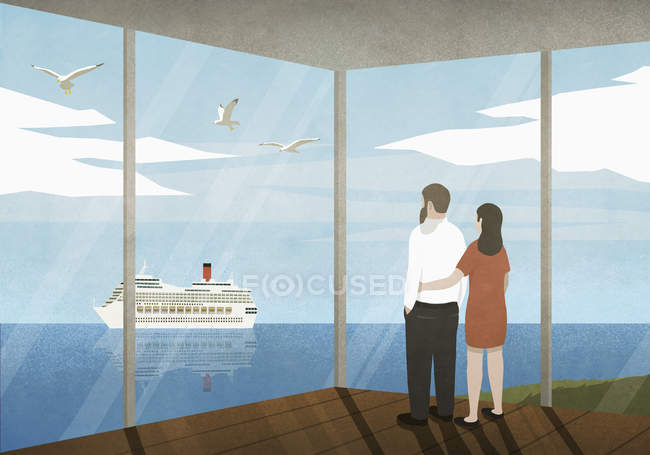 Couple watching cruise ship passing on ocean from beach house — Stock Photo