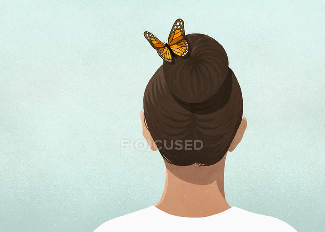 Butterfly in womans hair — Stock Photo