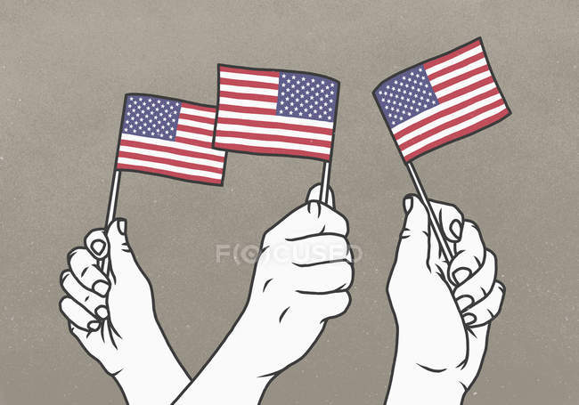 Hands waving small American flags — Stock Photo