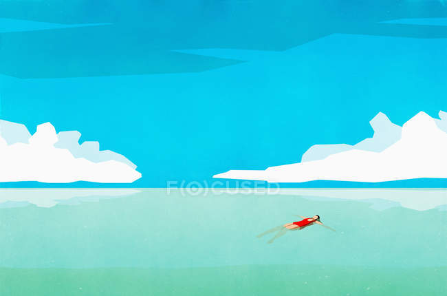 Serene woman floating on back in sunny turquoise ocean — Stock Photo