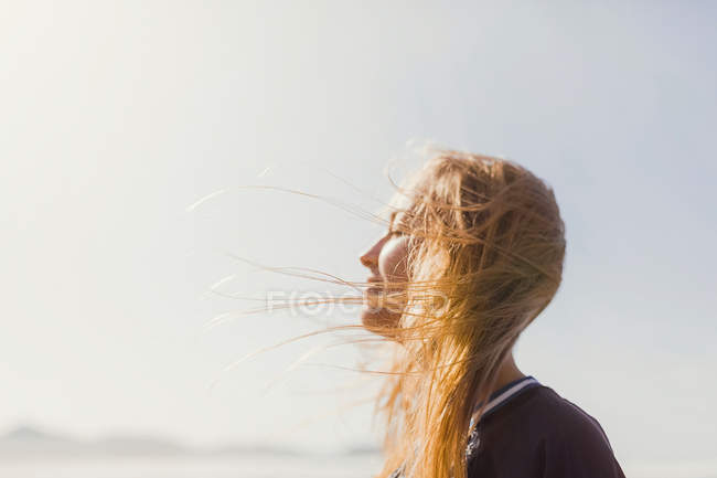 Serene woman basking in sunshine — Stock Photo