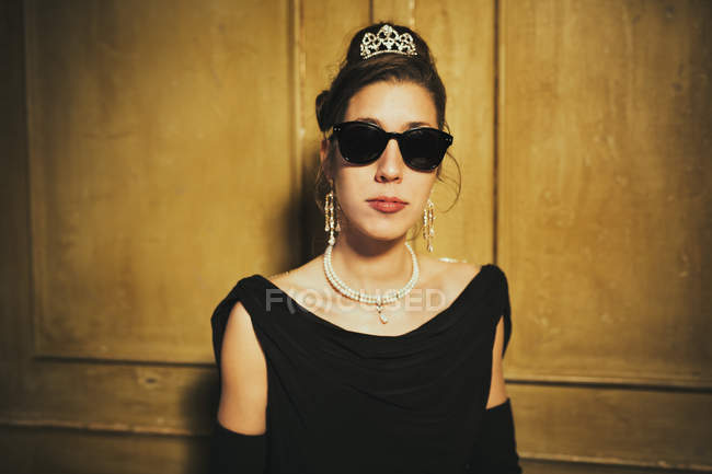 Portrait of confident, elegant woman wearing sunglasses and tiara — Stock Photo