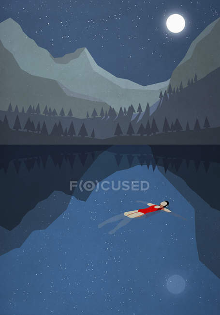 Moonlight shining over serene woman floating on back in tranquil mountain lake — Stock Photo