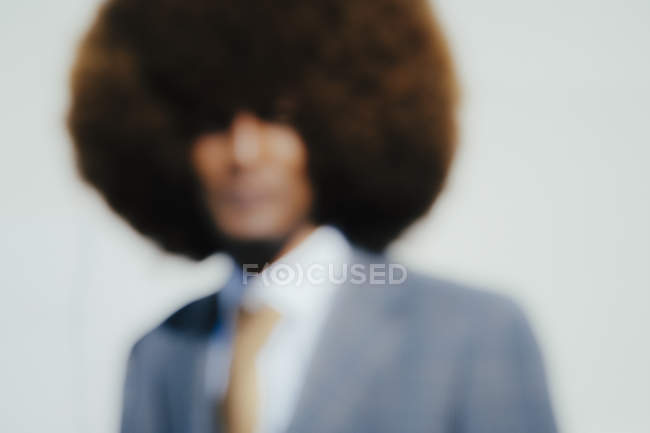 Defocused portrait well-dressed young man with afro — Stock Photo