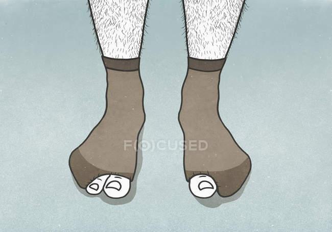 Большие пальцы торчат из отверстий в носках мужчин — стоковое фото