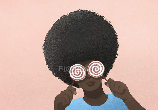 Portrait woman with afro holding lollipops over eyes — Stock Photo