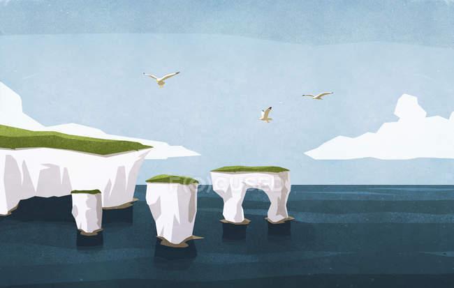Gaivotas voando sobre formações rochosas oceânicas — Fotografia de Stock