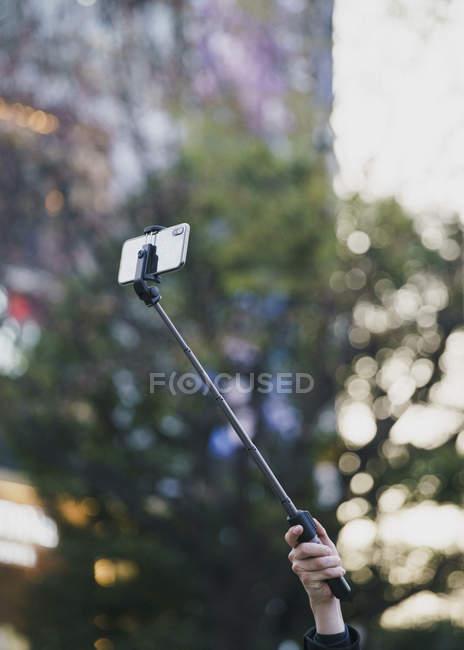 Tourist with selfie stick — Stock Photo