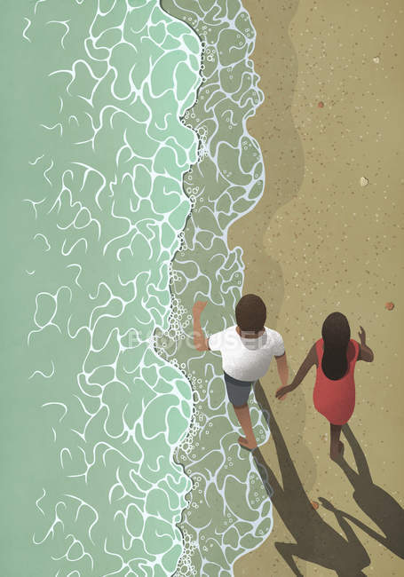 View from above couple holding hands, walking on ocean beach — Stock Photo