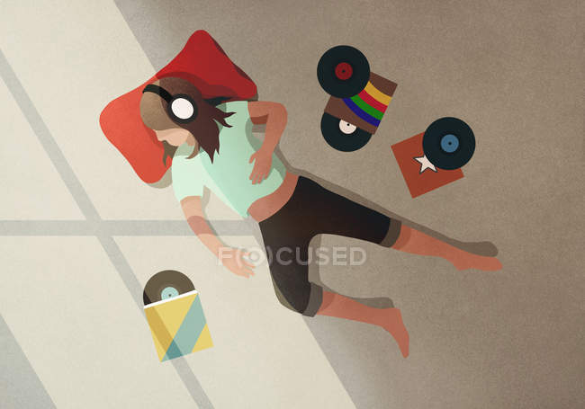 Carefree girl with headphones listening to records — Stock Photo