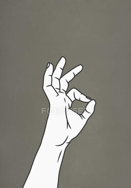 Жест рукой хорошо на сером фоне — стоковое фото