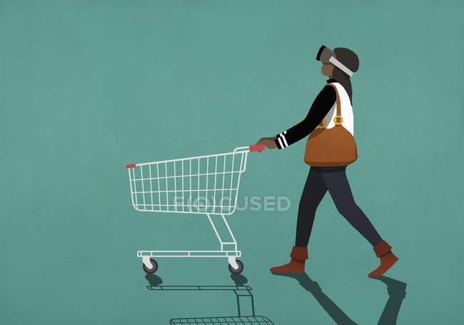 Woman with virtual reality simulator pushing shopping cart — Stock Photo